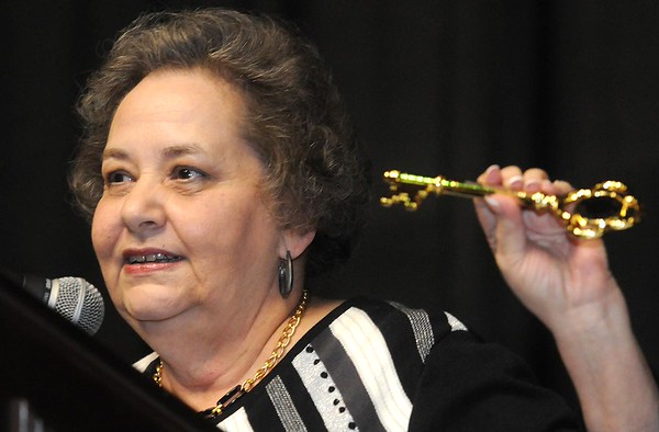 Lynn O'Brien holds up the key to the City of Beckley that was presented to Charlie Houck, during the Spirit of Beckley Community Service Award Banquet held at the Beckley-Raleigh County Convention Center Monday night.