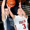 Parkersburg South's Logan Lawrentz, left, defends as Hurrican's Alexander Estep, right, drives for the basket during Friday evening action in the Big Atlantic Classic. F. Brian Ferguson/The Register-Herald