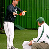 Blake Herring (left), pitching coach at Carson-Newman College in Jefferson City, Tennessee, speaks during a coaching symposium at the Upper Deck Training Center off Ragland Road Saturday afternoon. West Virginia Miners manager and Upper Deck owner Tim Epling is hosting the symposium, which will feature Houston Astros pitching coach Brent Strom today.<br /> Brad Davis/The Register-Herald