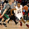 Woodrow Wilson's Donte Nabors speeds around Winfield's Taylor Hearn during the Eagles' win over the Generals Friday night in the Woodrow gym.<br /> Brad Davis/The Register-Herald