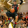 Oak Hill Academy's Caleb Martin finishes off a dunk as Greenbrier East's Obi Romeo is powerless to stop it as the nationally ranked Warriors defeated the Spartans Tuesday night in Fairlea.<br /> Brad Davis/The Register-Herald