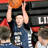 Nicholas County's Cody McClung pulls down a rebound against Liberty  during Friday evening action in Glen Daniels F. Brian Ferguson/The Register-Herald