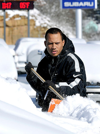Wednesday morning temperatures were at 5 degrees as Hometown Subaru Product Specialist Drew McKinney lended a hand in clearing the snow off the new cars on the lot. F. Brian Ferguson/The Register-Herald