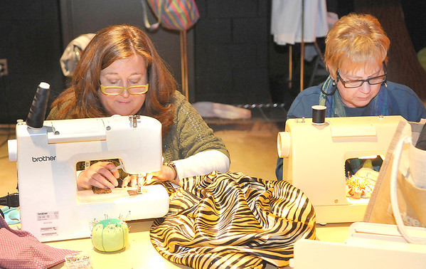 """Woodrow Wilson teachers Mary Jo Snow, left, and Diane Bridi, right, work on some costumes, onThursday evening,  during a rehearsel for the play, """"Into The Woods."""" F. Brian Ferguson/The Register-Herald"""