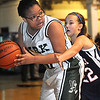 Makenzie Holley, of Independence, right, guards Neriah Calloway, of Park Middle School.<br /> Rick Barbero/The Register-Herald