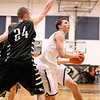Westside's Corey Bowles drives to the basket as Wyoming East's Logan Blankenship defends Saturday night in Clear Fork. <br /> Brad Davis/The Register-Herald