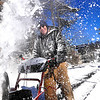 Jimmy Brown gives the snow blower a work out on Wednesday morning as he clears the entrance of Capitol Storage of the previous evenings drifts F. Brian Ferguson/The Register-Herald