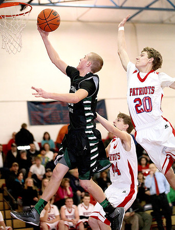 Wyoming East's Christian Hedinger sails past Independence's Bill Sargent for a score during the Warriors win against the Patriots Friday night in Coal City.<br /> Brad Davis/The Register-Herald