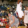 Bluefield's Azir Price flys over the top of Westside's Corey Bowles as he hesitates before going up for an easy layup during the opening night of the Big Atlantic Classic Monday at the Beckley-Raleigh County Convention Center.<br /> Brad Davis/The Register-Herald.