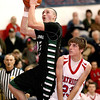 Wyoming East's Austin Canada goes up for layup as Indy's Adam Tolliver tries not to foul during the Warriors win Friday night in Coal City.<br /> Brad Davis/The Register-Herald