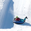 5-year-old Holden Hobbs holds on tight as he races down the snowtubing hill at Winterplace Ski Resort Saturday afternoon. Hobbs came to Winterplace as part of a group that traveled from Riverchase Baptist Church all the way down South in Hoover, Alabama.