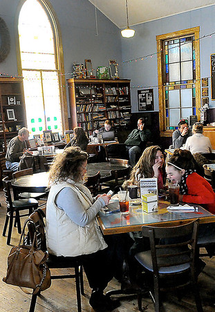 SNOW DAY=Jennifer McLain, left, daughter Alex McLain, 11, center, and friend Haylee Ayers, 10, right, all seem to be enjoying their snow day off of school as they take in a late breakfest at the Cathedral Cafe in Fayetteville.  F. Brian Ferguson/The Register-Herald