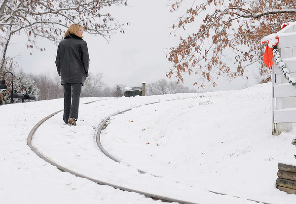 Leslie Baker, direction of operation, Beckley Exhibition Coal Mine and Youth Museum, walks on the track used by the mine at New River Park in Beckley Wednesday afternoon.<br /> Rick Barbero/The Register-Herald