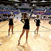 Members of the Westside High School cheerleading squad pump up the Warrior fans who during a timeout during the Warriors game against Bluefield High during the opening night of the Big Atlantic Classic at the Beckley-Raleigh County Convention Center. The annual tournament featuring 40 teams ranging from elementary to high school kicked off with five games.<br /> Brad Davis/The Register-Herald.
