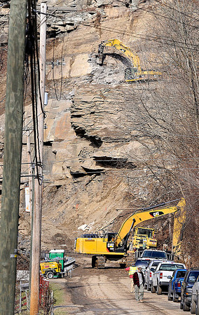 Duel excavators work on and above Rt.3, in Sundial, as crews continue attempting to clear the rockslide that has cut off the road that connects Raleigh and Boone Counties. F. Brian Ferguson/The Register-Herald