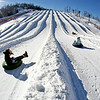 Snowtubers glide down their lanes at thrilling speeds during a sunny Saturday afternoon at Winterplace Ski Resort. With last week's winter storm Hercules giving way to clear skies and decent weekend weather, skiers, snowboarders and snowtubers traveled to Winterplace to take advantage of all the snow left behind by the storm.<br /> Brad Davis/The Register-Herald