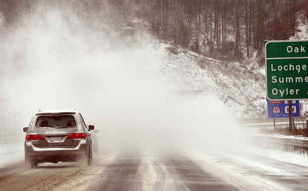 Strong wind gusts of blowing snow made morning driving difficult along Rt. 19 on Monday morning near Oak Hill. F. Brian Ferguson/The Register-Herald