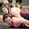Independence's Asaac Trotter squares off against Collins' Vincent Lopez Saturday afternoon during the Coalfields Conference Tournament at Shady Spring Middle School.<br /> Brad Davis/The Register-Herald