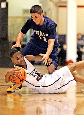 Woodrow Wilson's Jaylon Breckenridge and Shady's Joshua Snyder battle for a loose ball during the Flying Eagles blowout win Monday night at the Beckley-Raleigh County Convention Center.<br /> Brad Davis/The Register-Herald