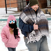Kaileigh Alfing, 8, left, is joined by her father, Ed Alfine for a brisk walk to get coffee during the recent cold snap in Fayetteville.  F. Brian Ferguson/The Register-Herald