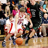 Indy's Adam Tolliver dribbles the ball up court against a press from Wyoming East's Austin Canada Jan. 24 in Coal City.<br /> Brad Davis/The Register-Herald