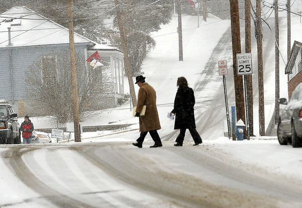 The Monday morning commute was a bit tricky as area residents made there was across Maple Avenue in Fayetteville. F. Brian Ferguson/The Register-Herald
