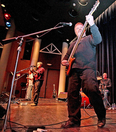 The Christian rock band FOG performs at Tamarack's Governor Hulett C. Smith Theater Sunday afternoon. Better known around the area as Four Old Guys, the four-piece band is comprised of guitarists and vocalists Dave Saunders and Dean Bibb, Marty Cole on drums and Brad Farha, pictured nearest, on bass and vocals. Brad Davis/The Register-Herald