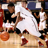 Woodrow Wilson's Dai-Dai Fortune hustles the ball up the court as Hurricane's Dylan Tinsley tries to keep pace Saturday afternoon at the Beckley-Raleigh County Convention Center.<br /> Brad Davis/The Register-Herald