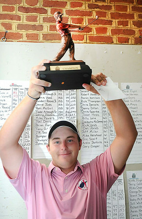 Davey Jude holds up the trophy after winning the BNI on the Cobb course at Glade Springs.<br /> Rick Barbero/The Register-Herald
