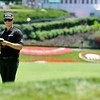 Chris Stroud goes over notes as he prepares for a shot from the fairway on 1 during the Greenbrier Classic Saturday in White Sulphur Springs.<br /> Brad Davis/The Register-Herald