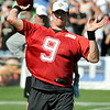 Brad Davis/The Register-Herald<br /> Saints quarterback Drew Brees drops back to throw a pass during practice Saturday afternoon in White Sulphur Springs.