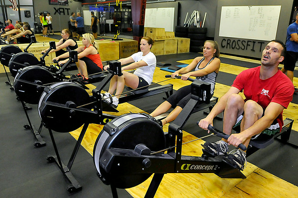 CrossFit Beckley participants warm up for their session July 15 at L.A. East Fitness on Mountaineer Drive.<br /> Brad Davis/The Register-Herald