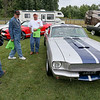 Daniels resident Alex Adkins, left, Hinton resident Dean Cline, middle, and Madison resident Billy Brown drool over a rare 1965 Shelby Cobra 40th Anniversary 427 during the 11th Annual Friends of Coal Auto Fair Saturday afternoon the YMCA Paul Cline Memorial Youth Sports Complex.<br /> Brad Davis/The Register-Herald