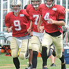 Saints three quarterback, Drew Brees, left, Luke McCown, and Ryan Griffin, doing running drills durin the New Orleans Saints fourth day of training camp on the new practice fields at The Greenbrier Resort.<br /> Rick Barbero/The Register-Herald