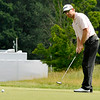 George McNeill putts on 17 during the final round of the Greenbrier Classic Sunday in White Sulphur Springs.<br /> Brad Davis/The Register-Herald