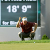 Billy Hurley III eyeballs his next putt on 18 during the Greenbrier Classic Saturday in White Sulphur Springs. He shot a 67 to stay in first place at 12-under heading into today.<br /> Brad Davis/The Register-Herald