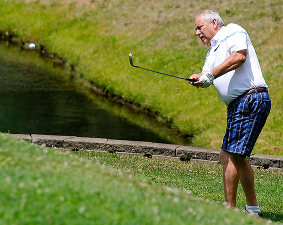Anstead resident Chuck Hurley chips onto the green on #3 during the second day of BNI tournament action Sunday afternoon at Brier Patch Golf Course.<br /> Brad Davis/The Register-Herald