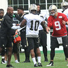 Drew Brees, right, shakes hands Brandin Cooks, a during after Cooks made a spectacluar catch from a pass from Brees during the first day of training camp on the new practice fields at The Greenbrier Resort.<br /> Rick Barbero/The Register-Herald