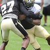 Mark Ingram, left, tries to break away from, Champ Bailey during the New Orleans Saints fourth day of training camp at The Greenbrier Resort.<br /> Rick Barbero/The Register-Herald