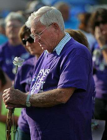 Cancer Survivor James White of Coal City joined his fellow survivors and caregivers for Friday evening's Relay for Life walk around the Crossroads Mall. F. Brian Ferguson/The Register-Herald