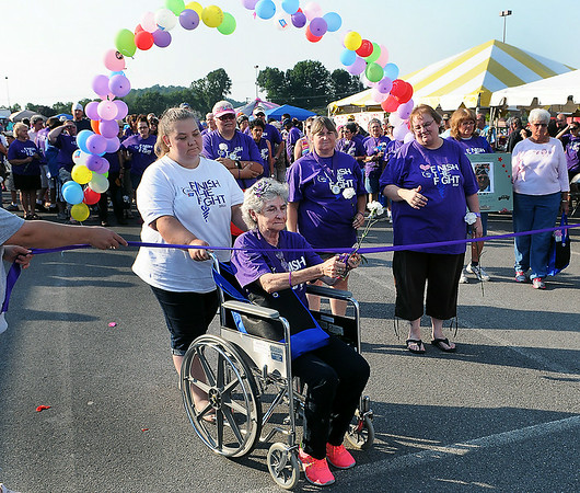 Long-time Relay for Life walker and cancer survivor Shelby White cut the ribbon for Friday evening's Relay for Life walk around the Crossroads Mall. F. Brian Ferguson/The Register-Herald