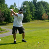 Clover, South Carolina resident Mark Hall winds up to drive the ball onto the fairway, or in the direction of the fairway at least, on the 10th hole at the Brier Patch Golf Course Saturday morning during the 34th annual BNI tournament.<br /> Brad Davis/The Register-Herald