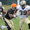 Travaris Cadet, 39,  runs the ball up field during  the New Orleans Saints fourth day of training camp  at The Greenbrier Resort.<br /> Rick Barbero/The Register-Herald