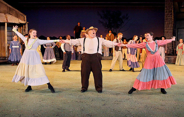 Actors perform during Theatre West Virginia's Hatfields & McCoys Friday night at Grandview Park's Cliffside Amphitheatre.<br /> Brad Davis/The Register-Herald