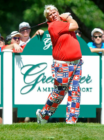 John Daly tees off on nine during the Greenbrier Classic Friday in White Sulphur Springs.<br /> Brad Davis/The Register-Herald