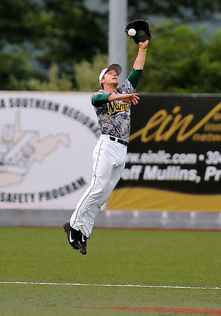 West Virginia shortstop Grant Massey leaps into the air to grab a line drive that would glance off his glove and into shallow center field Monday night at Linda K. Epling Stadium.<br /> Brad Davis/The Register-Herald