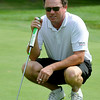 Ian Patrick looks over his next putt during the West Virginia Open Pro-Am Monday afternoon at Glade Springs Resort's Cobb golf course.<br /> Brad Davis/The Register-Herald