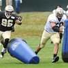 Chidera Uzo-Dirbe, left, and Thomas Welch run through some practice drills during the New Orleans Saints fourth day of training camp at The Greenbrier Resort.<br /> Rick Barbero/The Register-Herald