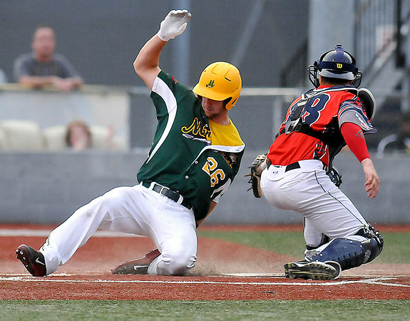 West Virginia's Westyn Baylor slides home safe as the ball gets past Chillicothe catcher Adam Gauthier during the bottom of the 4th inning Tuesday night at Linda K. Epling Stadium.<br /> Brad Davis/The Register-Herald