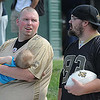 Robert May holding his son Blake May, 9 months, of Lewisburg, left, and Zach Arms, of Abingdon, Va. take in the New Orlean's Saints first day of training camp on the new practice fields at The Greenbrier Resort.<br /> Rick Barbero/The Register-Herald